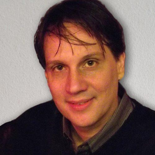 Carlos Mills